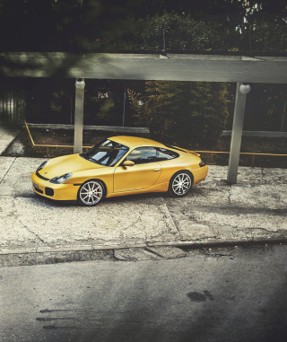 Картинка Yellow Porsche Carrera на телефон Nokia Lumia 800